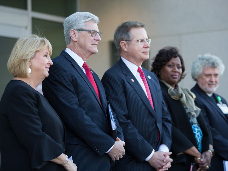 Joining Gov. Phil Bryant at ceremonies to formally name the Phil Bryant Medical Education Building were (standing, from left) his wife, Deborah; University of Mississippi Chancellor Jeffrey Vitter; Dr. Loretta Jackson-Williams, vice dean for medical education and professor of emergency medicine; and UMMC Chaplain Jeffrey Murphy.