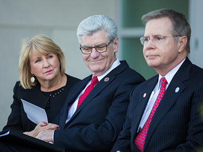 From left, First Lady Deborah Bryant, Gov. Phil Bryant and University of Mississippi Chancellor Jeffrey Vitter listen to remarks at a ceremony to formally name the Phil Bryant Medical Education Building.