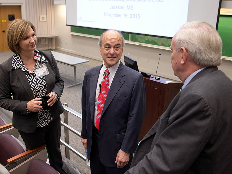 Dr. LouAnn Woodward, vice chancellor for health affairs, and Dr. Michael Henderson, chief medical officer, visited with The Join Commission's Dr. Mark Chassin (center) before his grand rounds presentation in 2015.