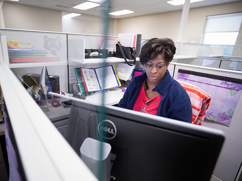 Physician scheduler Ketina Moore works at her station at the new JMMAC.