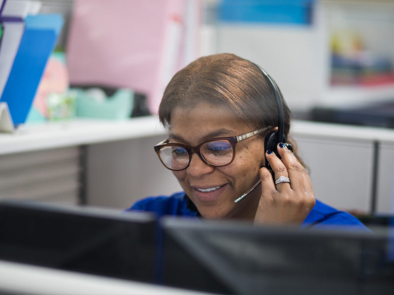 Physician scheduler Shameka Bailey-Ross takes a phone call at the new access center.