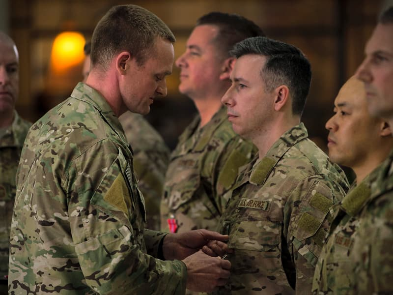 Maj. Justin Manley, third from right, receives the Bronze Star from his commander, Lt. Col. Eli Mitchell, second from left, during a Feb. 13 ceremony at the University of Alabama-Birmingham.