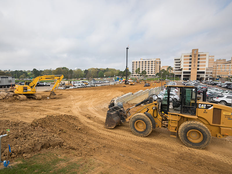 Construction of a new access road will connect East University Drive to Peachtree Street.