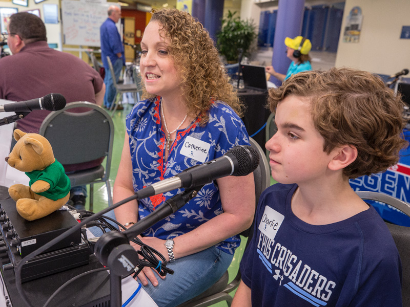 Catherine Faulk and her son, Charlie, a Batson Children's Hospital patient, tell their story during the Mississippi Miracles Radiothon Feb. 28.