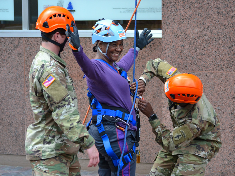 Dr. LaDonna Northington, assistant dean for undergraduate programs in the School of Nursing, gets harnessed up to rappel off the 14-story Trustmark building.