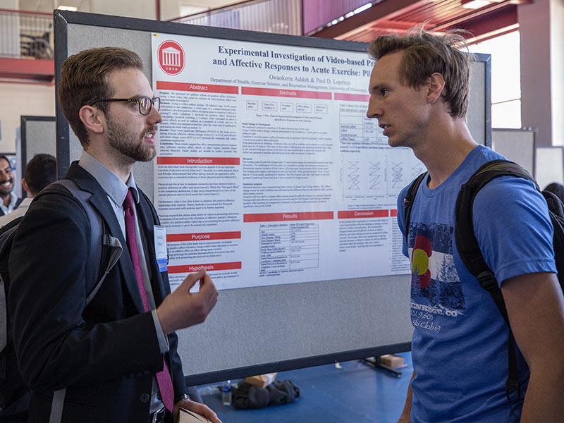 Jeremiah Blough, left, a graduate student in the School of Applied Sciences, discusses his research with Jeremiah Reese, a first-year medical student during a poster session.