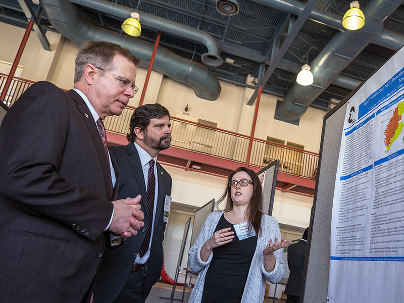 Caroline Canarios from the UM Center for Population Studies talk to UM chancellor Dr. Jeffrey Vitter and UM vice chancellor for research Dr. Josh Gladden about the Right! from the Start breastfeeding program, which includes investigators from the Oxford and Jackson campuses.