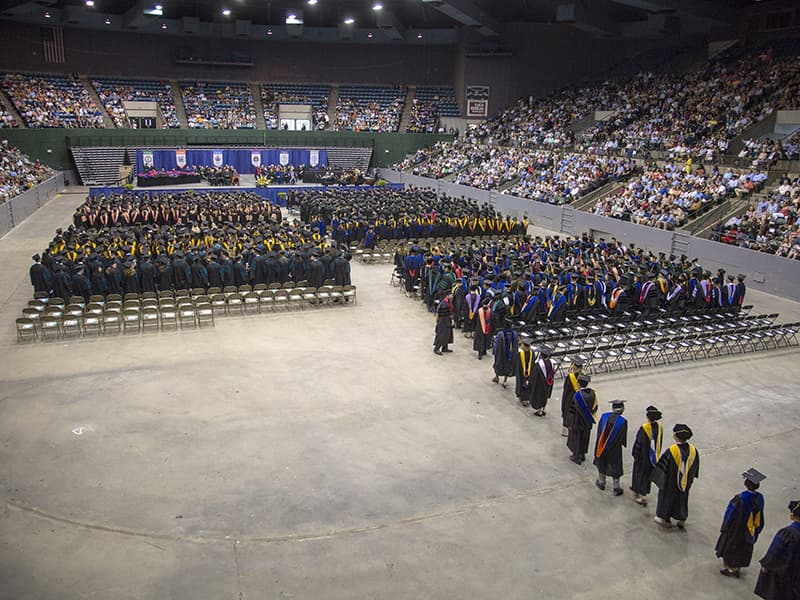 UMMC's Class of 2018 processes into the Mississippi Coliseum on the Fairgrounds in Jackson. Of this year's 930 graduates, 677 attended commencement to receive their diplomas.