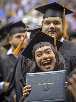Julianne Ranis is exuberant after receiving her bachelor of science in nursing during UMMC commencement ceremonies.