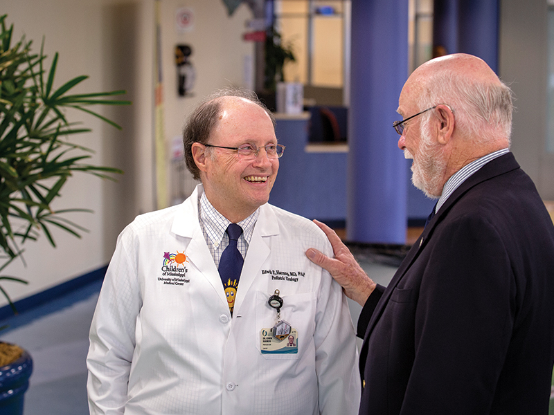 Dr. Edwin Harmon and Dr. James Keeton, friends and colleagues since the 1970s, share a conversation in the lobby of Batson Children's Hospital.