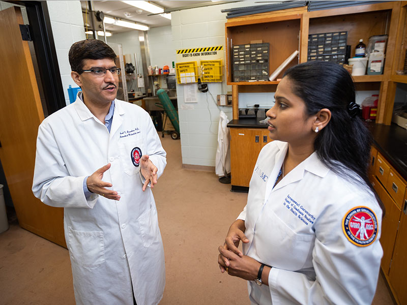 Janorkar, left, speaks with graduate assistant Bhuvaneswari Gurumurthy.