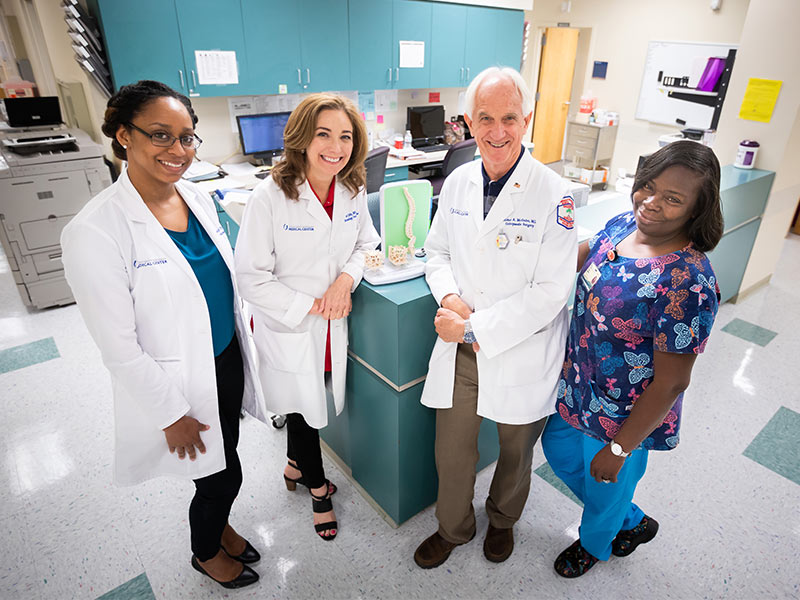 UMMC's Secondary Fracture Clinic team includes, from left, nurse practitioners Twyner and Janet Jolly, orthopedic surgeon Dr. Bob McGuire and medical administrator Olivia Morris.