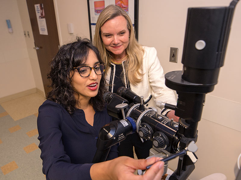 Dawoud and her mentor Dr. Kimberly Crowder, ophthalmology chair, review the merits of an optical instrument designed for glaucoma patients.