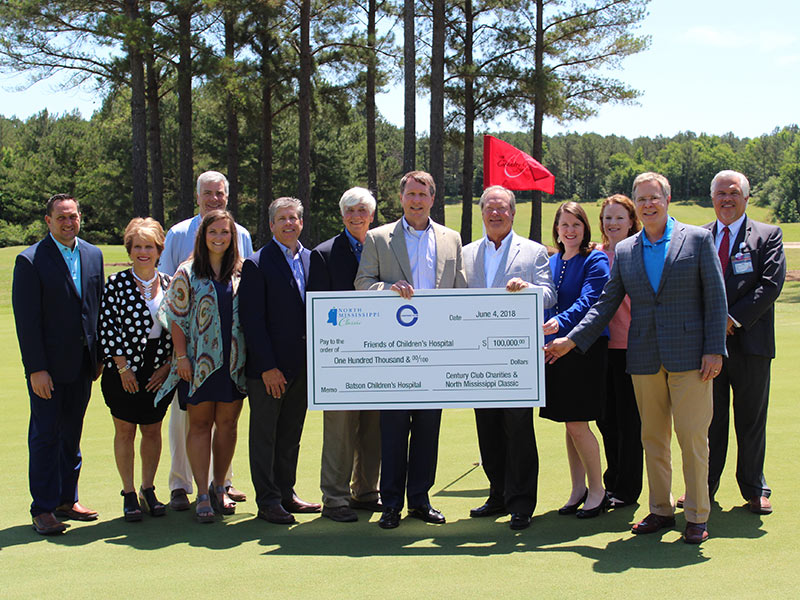 Celebrating the first check presented from the North Mississippi Classic to Friends of Children's Hospital are, from left, John Fassinger, Country Club of Oxford general manager; Becki Huelse; Mark Huelse; Nikki Paine; Steve Jent; Larry Britt; Jeff Hubbard, Century Club Charities president; Sidney Allen, Century Club Charities board chairman; Natalie Hutto, UMMC chief development officer; Emily Lewis, Children's of Mississippi finance director; Dr. Jeffrey Vitter, University of Mississippi chancellor; and Keith Parker, Children's of Mississippi director of ambulatory operations.