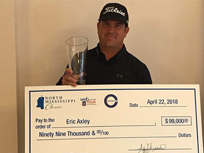 Web.com TOUR golfer Eric Axley shows his trophy and winnings from the inaugural North Mississippi Classic.