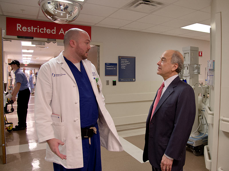 During his 2015 visit to the Medical Center, Dr. Mark Chassin, right, president and CEO of the Joint Commission, received a tour of the adult ED from its clinical director, Jason Zimmerman.