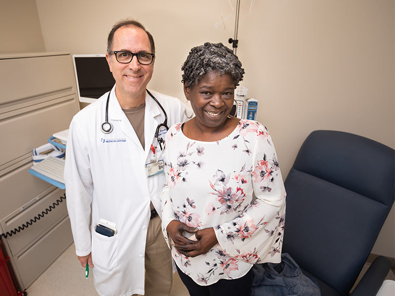 Dr. Louis Puneky is treating Linda Yassine of Jackson for colorectal cancer. She was diagnosed in 2007 at age 47 and says the ACS' new guidelines will save more lives.