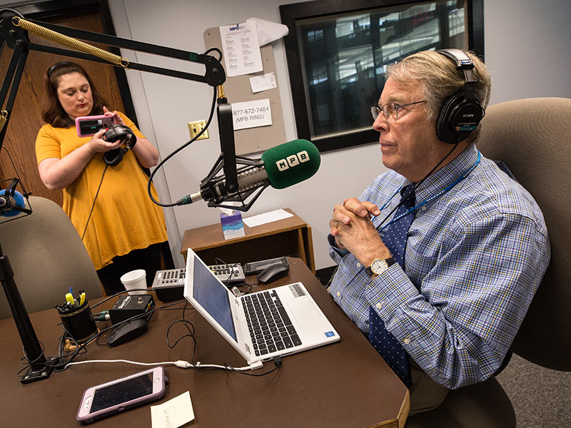 "As MPB digital media strategist Ellie Banks livestreams him on Facebook, Dr. Rick deShazo records his final ""Southern Remedy"" radio show."