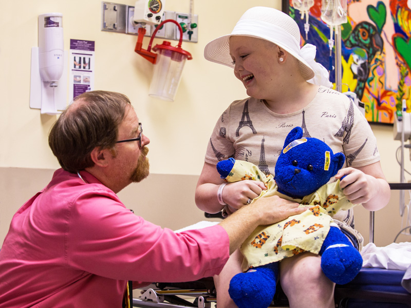 Dr. Anderson Collier checks the condition of Mary Frances Sutton of Monticello, a Children's Cancer Center patient, and her bear, Blueberry.