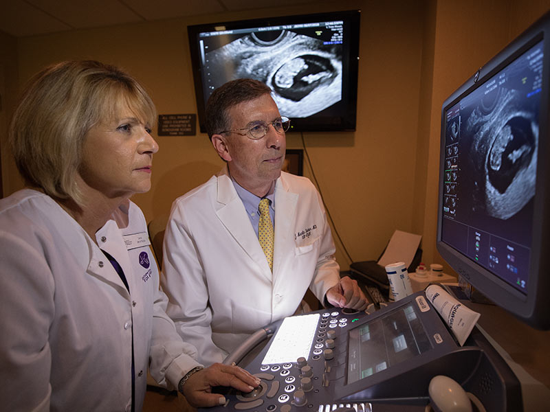 Dr. Marty Tucker, the 2018 Distinguished Medical Alumnus Award honoree, reviews a diagnostic image with with Jan Boykin, sonographer, at his Jackson Healthcare for Women clinic.