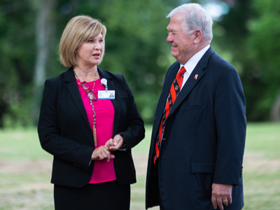 Dr. LouAnn Woodward, vice chancellor for health affairs and dean of the School of Medicine, chats with former Gov. Haley Barbour at groundbreaking ceremonies for the Mississippi Center for Emergency Services.