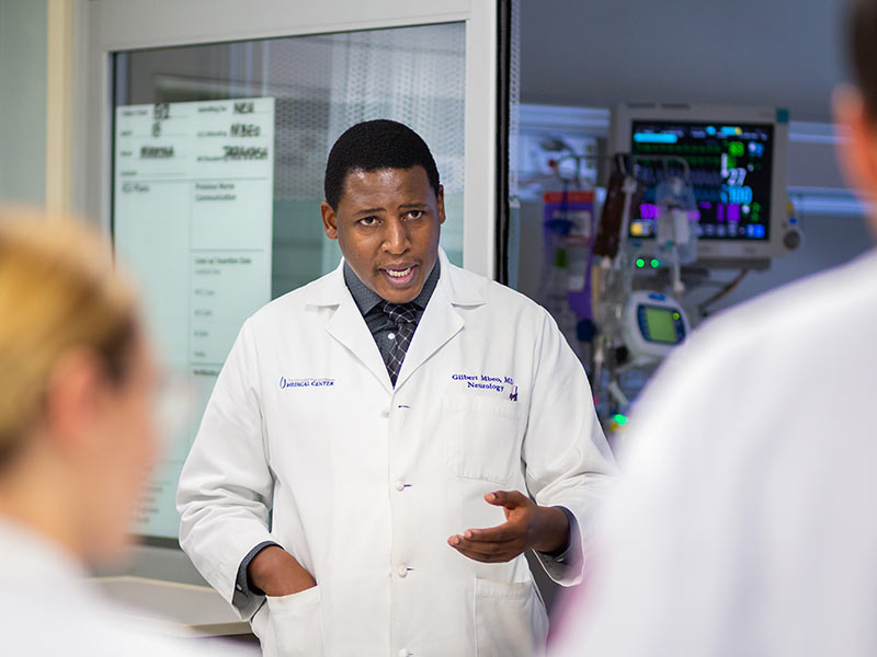 Dr. Gilbert Mbeo, assistant professor of neurology, teaches UMMC residents and medical students as part of rounding with them in the neuroscience ICU.