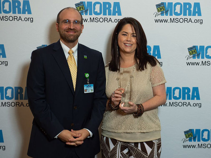 Michelle Crawford, abdominal transplant coordinator at UMMC Grenada, is  winner of MORA's Hospital Leadership of the Year Award. She's pictured with Russell Touchet, MORA's chief business officer.