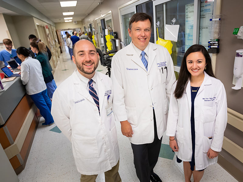 Dr. Jason Parham, center, leads UMMC's antibiotic stewardship program with clinical pharmacy specialists Dr. David Cretella and Dr. Mary Joyce Wingler.