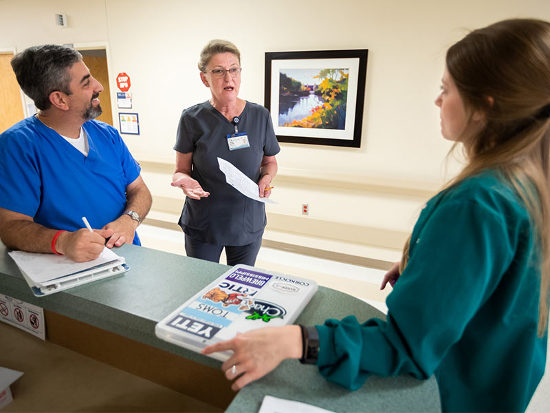Randy Khalaf, left, occupational therapist, Marina Baldwin, center, 3 North nurse manager, and Brandi Alexander, physical therapist, discuss care for post-surgery patients.