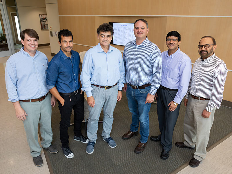 Among the several UMMC faculty using elastin-like polypeptides to study new ways to treat disease are, from left, Dr. Lee Bidwell, Dr. Alejandro Chade, Dr. Drazen Raucher, Dr. Eric George, Dr. Amol Janorkar and Dr. Parminder Vig.