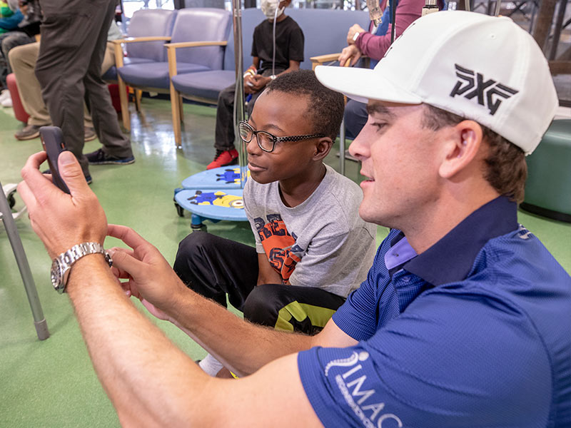 Sanderson Farms Championship golfer Scott Langley takes a selfie with Batson Children's Hospital patient Keydarius Taylor of Meridian.