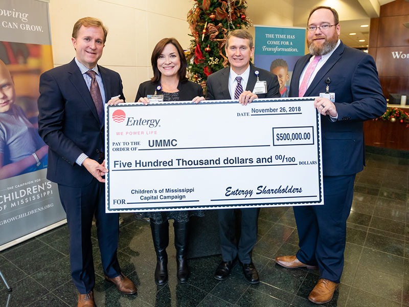 Holding a ceremonial $500,000 donation check to the Campaign for Children's of Mississippi are, from left, Entergy Mississippi president and CEO Haley Fisackerly, Dr. Mary Taylor, chair of Pediatrics, Guy Giesecke, CEO of Children's of Mississippi and Jonathan Wilson, UMMC Chief Administrative Officer.