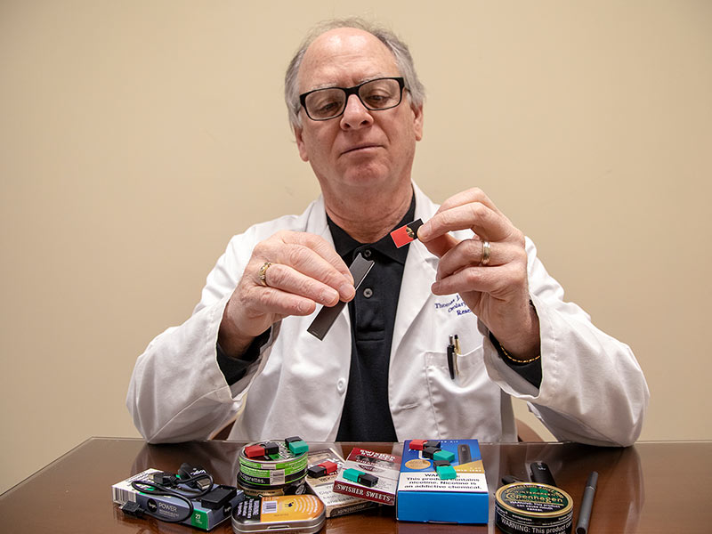 Dr. Thomas Payne explains the use of a Juul e-cigarette in the shape of a flash drive.