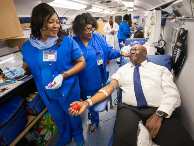 Claude Brunson donating blood.
