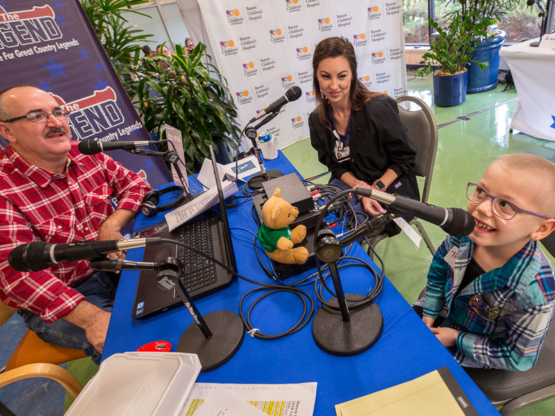 Mark McCoy of 100.9 The Legend interviews Children's of Mississippi patient Trinley Camp as her mom, Amanda, looks on.