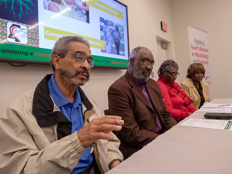 Four Jackson Heart Study participants sit at a table during a panel discussion
