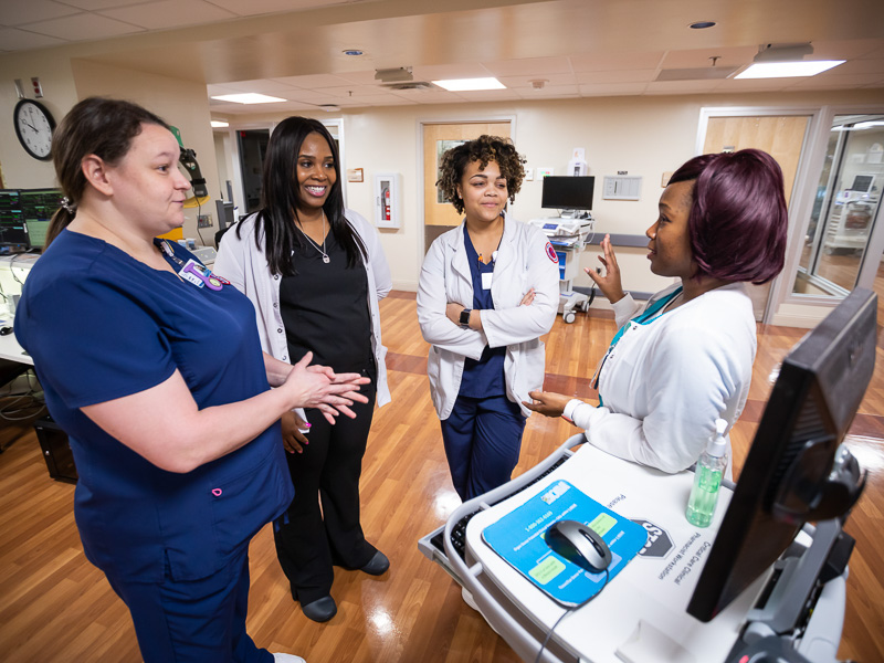 From left, Jennifer Morris, accelerated nursing student, LaVeChelle Pillers, VA nurse, Sarah Jamison, accelerated nursing student, and Joyce Sellers, VA nurse, chat about working together in the VA's intensive care unit.