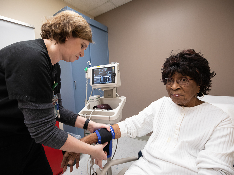 Lillie Rose Hines of Braxton has her blood pressure measured by Pamela Burleson, nurse, at the Medical Center.