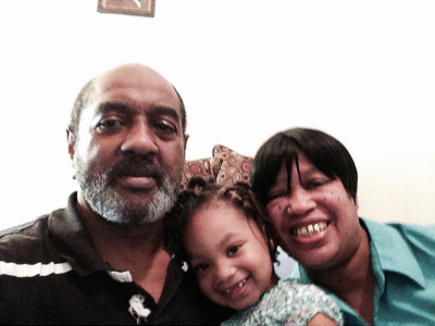 Lucious Thomas and wife Tammy with their granddaughter Ivyanna Thomas.