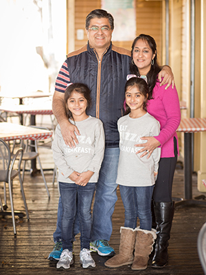 Manisha with husband Vikram Malhotra and their 8-year-old twin daughters Priya (left) and Asha Malhotra