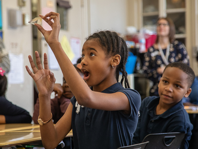 Barack H. Obama Magnet School fourth-grader Kennedi Bolden, 9, finds a rainbow using a glass prism. The lesson was part of Project REACH, an education program with the School of Graduate Studies in the Health Sciences.