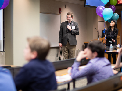 Jason Griggs, chair of the Department of Biomedical Materials Science, reads the question and possible answers aloud to students as Dr. Yuanyuan Duan, assistant professor of Biomedical Materials Science, looks on.