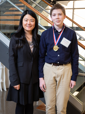 Dr. Yuanyuan Duan, associate professor in the Biomedical Materials Science department, with Joshua Bowman, Jackson's You Be the Chemist champion and 8th grader at Northwest Rankin Middle School.