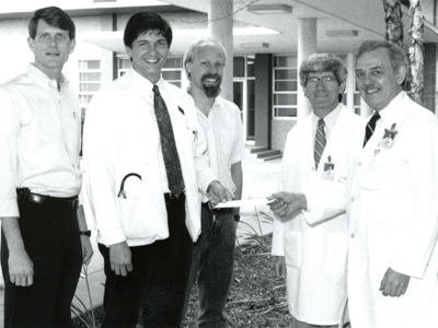 In this undated photo, Arceneaux, second from right, participates in a presentation near the original School of Medicine entrance. Among those present are the late Dr. Carl G. Evers, far right, professor of pathology and associate dean for Academic Affairs.