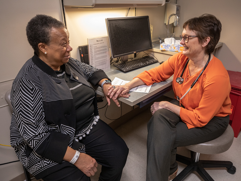 Marilyn Triplett, left, a multiple myeloma patient, talks to Dr. Stephanie Elkins, professor of hematology and oncology and head of the Division of Hematology and Oncology at the CCRI.