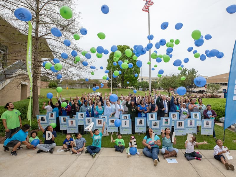 Dozens of transplant recipients and family members of organ donors gather for a balloon release at the conclusion of the Legacy Day celebration.
