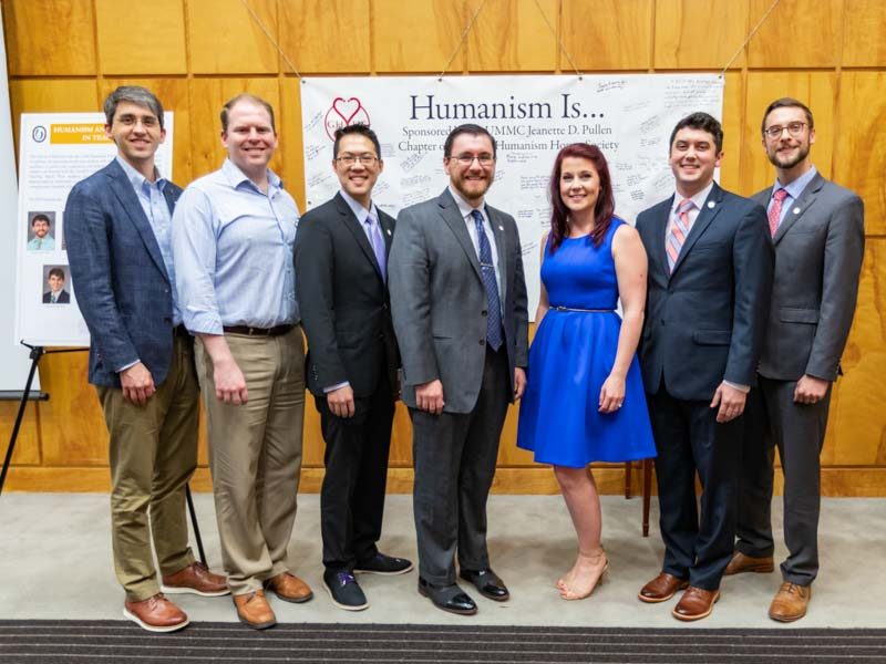 Residents honored during Tuesday's Gold Humanism Ceremony are, from left, Dr. John Rushing, Dr. Daniel Lyons, Dr. Michael Yeung-Lai-Wah, Dr. Dustyn Baker, Dr. Emily Grenn, Dr. John Caleb Grenn and Dr. Jacob Stout.