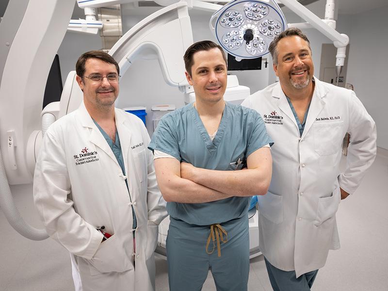 UMMC vascular surgery fellow Dr. Zachary Virgin, center, rotates at St. Dominic Hospital in Jackson. His mentors there are vascular surgeons Dr. Todd Cumbie, left, and Dr. Zachary Baldwin.