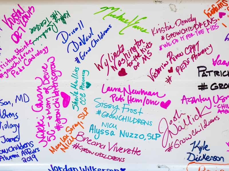 Signatures in a rainbow of Sharpie colors cover the beam that will be placed at the top of the children's expansion during a 4:30 p.m. ceremony June 27.