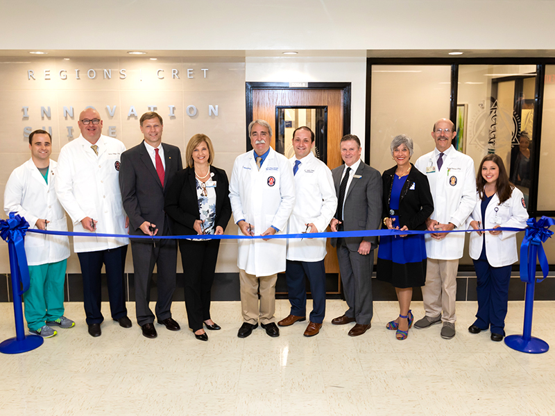 Left to right dental student Stephen Greer, Dr. Scott Phillips, John Boydstun of Regions, Dr. LouAnn Woodward, Dr. David Felton, Dr. Andres Pappa, Don Hobbs of CRET, Dr. Barbara Mauldin, Dr. Scott Gatewood, and dental hygiene student Brett Quon at the ribbon cutting ceremony for the Regions CRET Innovation Suite.